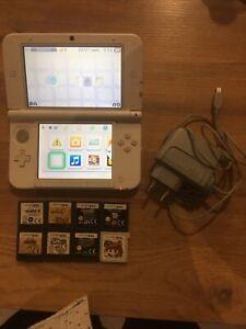 Nintendo 3DS XL Console Portable Blanche + Housse + 8 Jeux + Chargeur Officiel