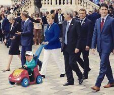 "ANGELA MERKEL PUSHING TRUMP IN BABY TOY AT G7 HUMOUROUS FRIDGE MAGNET 5"" X 3.5"""