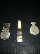 Vintage money clips. One is marked Kreisler Craft. Unsearched.