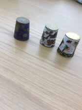 3 metal enamel decorated thimbles