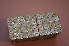 Une plaquette de 36 boutons de  nacre (2 trous), 10mm mercerie ancienne, couture