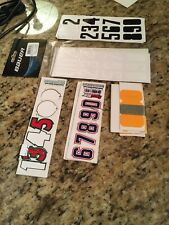 Assorted hockey helmet stickers (mostly numbers)