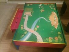Child's play table with reversible top and drawer in great shape.