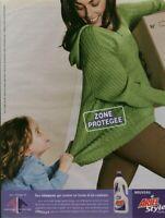 Publicité contemporaine lessive Ariel 2003 issue de magazine