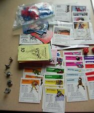 Replacement pieces for Spiderman Monopoly.  NOT COMPLETE