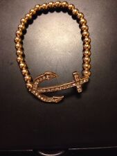 Gold Tone Stretchable Anchor Bracelet With Diamond Like Crystals
