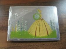 Art Deco period chrome stamp case with Crinoline Lady imagery