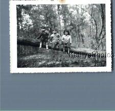 FOUND B&W PHOTO K_6211 KIDS SITTING ON LOG IN FOREST