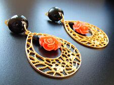 Ohrringe Ohrclips aus gold Farbe mit Blume aus Koralle , von  Catia Levy