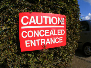 CAUTION! CONCEALED ENTRANCE, Sign