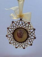 "Gold with red rhinestones Photo holder Christmas Ornament holds  2"" X 2"" picture"