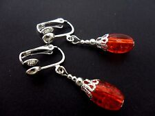 A PAIR OF PRETTY ORANGE  OVAL CRACKLE GLASS BEAD  CLIP ON EARRINGS. NEW.
