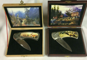 2 Brand new Hunting knife in case with buck picture on knife and box....