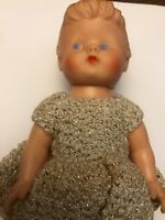 Vintage Doll with shiny shirt and white pants