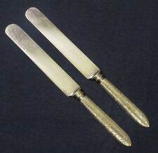 2 silverplated dinner knives Rogers & Bros. BROCADE 1886 embossed solid handles