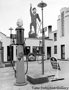 A Gravity Feed Gas Pump & Paul Bunyan, Bemidji, MN - 1939 - Vintage Photo Print
