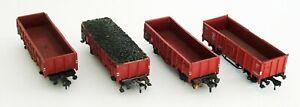 5 Fleischmann freight cars, 4 red, 1 green