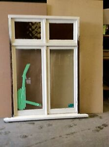 CASEMENT WINDOW WITH RED AND YELLOW GLASS