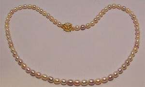 "Brand new  light multi-color freshwater cultured Pearl Necklace and is 20"" long."