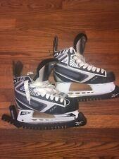 Kids Size 4.5 Ccm Pro E Ice Hockey Skates Black with Reebok Skate Guards.