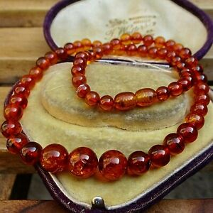 LOVELY STRING OF VINTAGE OR ANTIQUE AMBER BEADS