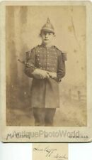 Young man Sam Legge in military uniform with clarinet antique cabinet photo