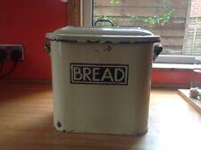 Vintage Enamel Bread Bin. Dark cream/butter coloured with green handles.