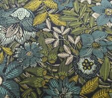 Black background with green, teal, beige, flowers and leaves. Andover Fabrics