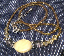 with a silver tone metal Very pretty single string beaded necklace