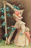 Girl playing Harp Embossed Vintage Postcard 03.43
