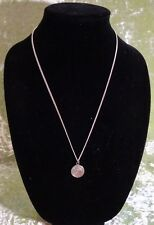 NECKLACE WITH A SILVERTONE MEDALLION