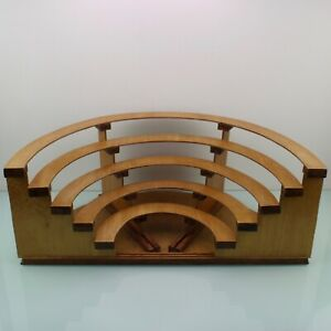 Art Deco colosseum like handcrafted wooden shop display stand.