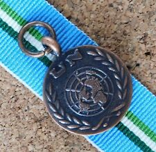 UNTEA UNITED NATIONS MINIATURE MEDAL WITH 10CM RIBBON UN