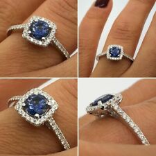 18CT WHITE GOLD 0.85CT SAPPHIRE AND DIAMOND HALO RING GOY907