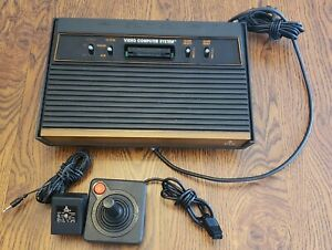 Atari 2600 Woodgrain 4-Switch Console With Controller and Power Adapter