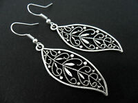 A PAIR OF TIBETAN SILVER LONG LEAF THEMED DANGLY EARRINGS. NEW.
