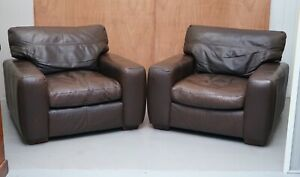 PAIR OF CHOCOLATE BROWN LEATHER CONTOUR ARMCHAIRS