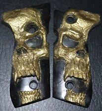 Beretta 92FS pistol grips gold skull on black plastic