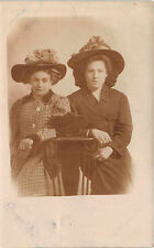 Two Ladies Leaning On Chair Decorative Hats CB.186