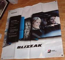 BRIDGESTONE BLIZZAK TIRES BANNER, 4' x 4'; NEW AND UNUSED