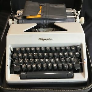 Nice Vintage Olympia DeLuxe Typewriter in Portable Case with Toolkit CLEAN!