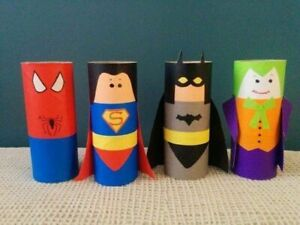 Superhero toys, super heroes recycled from toilet paper cores.
