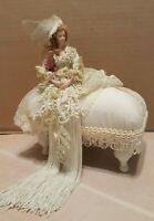 Popular Creations Tassel Doll on Ottoman 2004