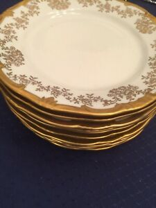 Weimar Katharina White /Gold Floral Porcelain Eleven Bread & Butter Plates.