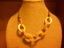Necklace from Avon (new) OFF WHITE LOOPS W/BROWN & BRASS