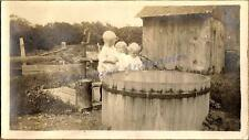 1910s Young Country Girls Standing at Hand Water Pump Cistern Tank Trough Photo