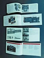 Lot four 35mm camera operating manuals for CONTAX, POLAROID, CANON TLb FD photos