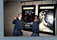 Found Color Photo I+2991 Teen Girls In Uniforms Posed By Posters In Theatre