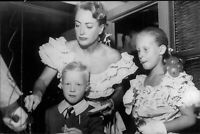 Joan Crawford cutting the birthday cake to her children - 8x10 photo