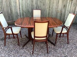 DANISH ROSEWOOD RETRO DINING TABLE AND FOUR CHAIRS